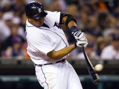 Tigers shortstop Jhonny Peralta belts a two-run home run in the bottom of the ninth inning Friday, giving Detroit the win over Chicago.