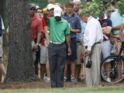 Tiger Woods takes a drop on the fifth hole during the second round of the Wells Fargo Championship.