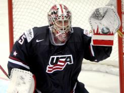 USA goalie Jimmy Howard makes a glove save during a 7-2 win against France in the world championships opener.