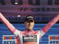 Taylor Phinney of the United States celebrates as he wears the overall leader's pink jersey he received after after winning the first stage of the Giro d'Italia Saturday.