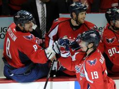 Capitals center Nicklas Backstrom (19) celebrates his second-period goal with teammate Alex Ovechkin (8) and the rest of the Washington bench.