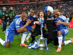 From left, Didier Drogba, Salomon Kalou, David Luiz, Michael Essien and Florent Malouda celebrate Chelsea's victory in the FA Cup final.