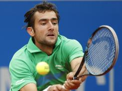 Marin Cilic of Croatia reaches for a backhand during his semifinal victory Saturday against Tommy Haas of Germany in the BMW Open in Munich.