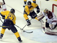 Predators right wing Patric Hornqvist (27) and center Mike Fisher (12) try to shoot the puck past Coyotes goalie Mike Smith in the third period, but can't find the back of the net.