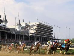 Dullahan with jockey Kent Desormeaux aboard leads the field around the first turn during the 138th Kentucky Derby on Saturday.