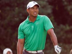 Tiger Woods shows his frustration on the 11th tee on his way to missing the cut Friday at the Wells Fargo Championship.