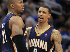 George Hill scored 11 of his 12 points in the fourth quarter and overtime for the Pacers.