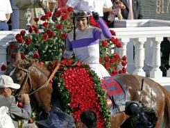 Jockey Mario Gutierrez celebrates after riding I'll Have Another to victory in the 138th Kentucky Derby on Saturday.