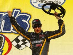 Joey Logano, driver of the No. 18 car, celebrates in victory lane after winning the Aaron's 312 at Talladega Superspeedway.