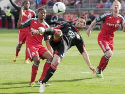 Hamdi Salihi, center, scores D.C. United's second goal to secure a 2-0 win over Toronto FC.