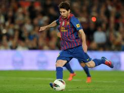 Lionel Messi pushed his season total to an unprecedented 72 goals with four against Espanyol.