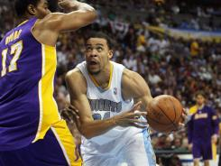 Denver Nuggets center JaVale McGee (34) drives to the basket against Los Angeles Lakers center Andrew Bynum (17) during the first half of Game 3 on Friday at Denver.