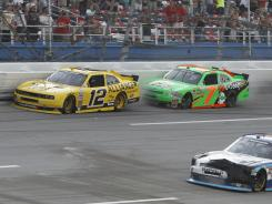 The cooldown lap was anything but as Danica Patrick (7) puts Sam Hornish Jr. (12) into the wall at Talladega Superspeedway. Patrick was retaliating for Hornish squeezing her during the final lap.