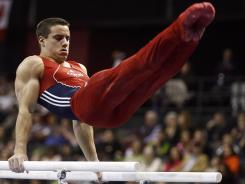 Jake Dalton competes on the parallel bars in the 2012 Pacific Rim Championships at Comcast Arena in Everett, Wash., on March 17.