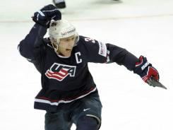 Jack Johnson celebrates his overtime goal that gave the USA a 5-4 win vs. Canada on Saturday in a preliminary-round match in the Ice Hockey World Championships.