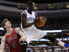 Guard Jrue Holiday, with the ball, had 16 second-half points to help the Philadelphia 76ers beat the Chicago Bulls on Sunday to go up 3-1 in their Eastern Conference playoff series.