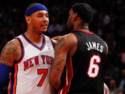 Forward Carmelo Anthony, left, came up with the big game the New York Knicks needed with 40 points to help beat LeBron James, right, and the Miami Heat on Sunday.