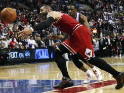 Chicago Bulls forward Carlos Boozer can't help but wonder if the series vs. the Philadelphia 76ers would be different if Derrick Rose and Joakim Noah were not injured.