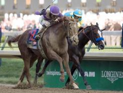 Mario Gutierrez aboard I'll Have Another (right) crosses the finish line to win the Kentucky Derby at Churchill Downs. Bodemeister was second.