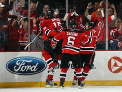 Devils players celebrate Dainius Zubrus' second-period goal during Game 4 on Sunday in Newark, N.J.