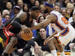 Baron Davis, right, is the latest New York Knick to get injured, hurting his right knee in Sunday's Game 4 vs. the Miami Heat.
