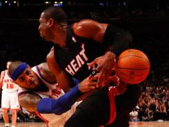Dwyane Wade, right, couldn't hit the shot at the end to keep the Heat from losing Game 4 to the Knicks.