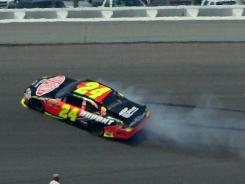Jeff Gordon spins in Turn 3 at Talladega Superspeedway. He was knocked out after 142 of a scheduled 188 laps.