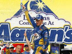 Brad Keselowski celebrates in victory lane after slipping past Kyle Busch at the finish to win the Aaron's 499 at Talladega Superspeedway.