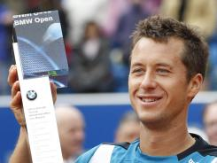 Philipp Kohlschreiber of Germany lifts the trophy after defeating Marin Cilic of Croatia in the BMW Open in Munich.