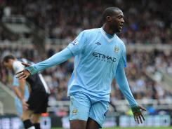 Yaya Toure of Manchester City celebrates after his goal gave City a 2-0 lead over Newcastle.