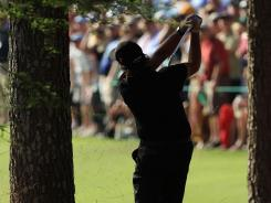 Shots such as this one from the pine needles on the 13th hole during the final round of the 2010 Masters show Phil Mickelson's aggressive style.