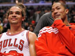 Joakim Noah, left and Derrick Rose, right, will be on the sidelines Tuesday as their Chicgo Bulls face playoff elimination by the Philadelphia 76ers.