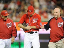 Nationals outfielder Jayson Werth leaves his team's game against the Phillies Sunday after injuring his wrist while trying to make a catch. On top of Werth's injury, the Nationals also got blown out 9-3.
