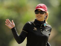Pornanong Phatlum of Thailand acknowledges the cheers on the eighth green on her way to victory Sunday in the LPGA Brazil Cup.