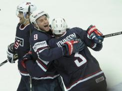 Jack Johnson, right, celebrates with Max Pacioretty, left, and Bobby Ryan after a win vs. Canada.