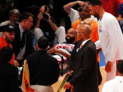 New York Knicks guard Baron Davis was able to smile when he left on a stretcher after injuring his knee Sunday, but test results Monday indicated a far more serious problem for the 33-year-old.