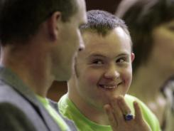 Eric Dompierre, may get to play next season if a proposal passes that would allow an age-limit waiver in Michigan. Dompierre, who has Down syndrome, won't be able to play football or basketball next school year at Ishpeming, Mich., if the current rule stands.