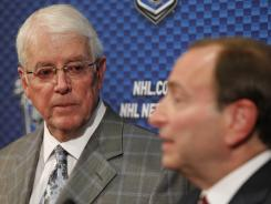 Prospective Phoenix Coyotes owner Greg Jamison, left, listens to NHL commissioner Gary Bettman during Monday's news conference.
