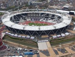 An aerial view of the Orbit and Olympic Stadium around the perimeter of London's Olympic Park. Olympic organizers said Monday they were looking into a tabloid's report claiming that a worker had been able to sneak a plastic container with batteries, a phone and modeling clay into Olympic Park.
