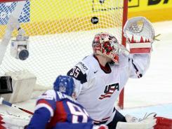Slovakia's Branko Radivojevic scores his team's second goal against U.S. goalie Jimmy Howard on Monday.