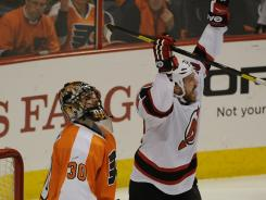 New Jersey Devils right wing David Clarkson celebrates his first-period goal against Philadelphia Flyers goalie Ilya Bryzgalov.