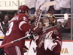 Coyotes defender Oliver Eckman-Larsson, left, and goalie Mike Smith celebrate after eliminating the Predators 2-1 in Game 5 of the Western Conference semifinals.