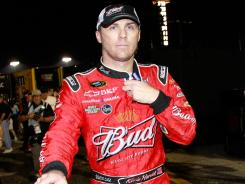 Kevin Harvick tosses a water bottle after scuffling with Kyle Busch following last year's Southern 500.