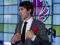 Phoenix Suns basketball player Steve Nash appears at a news conference where he was introduced as the general manager of Canada's national basketball program in Toronto on Tuesday.
