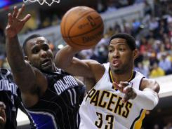 Indiana Pacers small forward Danny Granger (33) passes the ball off as Orlando Magic power forward Glen Davis (11) defends during the Pacers' Game 5 win on Tuesday.