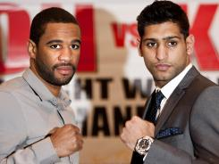 the May 19 rematch between Lamont Peterson, left, and Amir Khan is in jeopardy of being canceled.