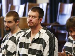 Former NFL quarterback Ryan Leaf, center, sits in a Cascade County courtroom on May 8, 2012, in Great Falls, Mont.