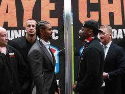 David Haye, left, and Dereck Chisora are separated by a fence as they face off during a press conference to announce their fight on Tuesday.