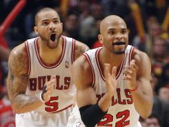 Chicago Bulls' Carlos Boozer and Taj Gibson react to a Chicago point run late in the second quarter during Game 5 on Tuesday.