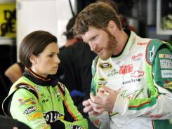 Dale Earnhardt Jr. talks with Danica Patrick during a late-March race weekend in Fontana, Calif. Patrick drives a No. 7 Chevrolet for JR Motorsports, Earnhardt's Nationwide Series team.